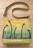 sac-en-laine-feutrée-anis-végétaux-noirs-turquoises-gauche